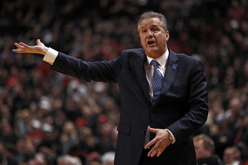 Kentucky coach John Calipari yells out to his players during the first half of an NCAA college basketball game against Texas Tech, Saturday, Jan. 25, 2020, in Lubbock, Texas. (AP Photo/Brad Tollefson)