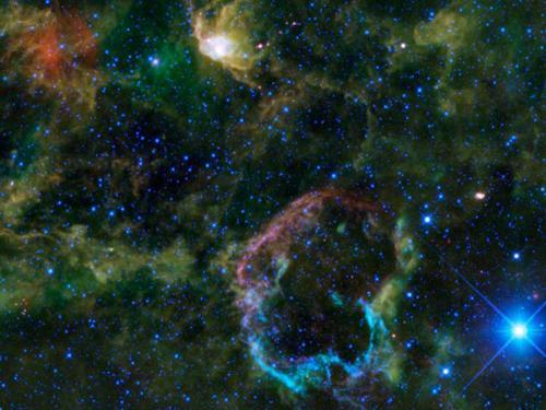 Photo by: NASA/JPL-Caltech/WISE Team<br>Jellyfish nebula-<br>This WISE images shows IC 443, also known as the jellyfish nebula, which is located 5,000 light-years away from Earth inside the Gemini constellation. About 5,000 to 10,000 years ago, a massive star at the center exploded, forming a jellyfish-shaped shell around its remains.