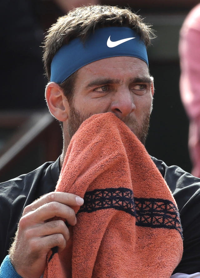 Argentina's Juan Martin Del Potro wipes his face as he plays Spain's Rafael Nadal during their semifinal match of the French Open tennis tournament at the Roland Garros stadium, Friday, June 8, 2018 in Paris. (AP Photo/Alessandra Tarantino)
