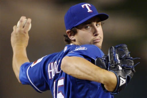 Texas Rangers starting pitcher Derek Holland throws to the plate during the second inning of their baseball game against the Los Angeles Angels, Wednesday, Sept. 19, 2012, in Anaheim, Calif. (AP Photo/Mark J. Terrill)