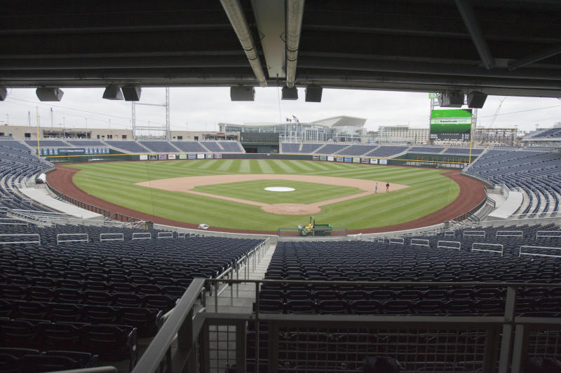 Omaha's new TD Ameritrade Park is seen in Omaha, Neb., Monday, April 18, 2011. About two dozen dignitaries cut the ribbon on TD Ameritrade Park on a cloudy, blustery afternoon in downtown Omaha. The 24,000-seat stadium replaces Rosenblatt Stadium as the home for the College World Series, which has been played in Omaha every year since 1950. (AP Photo/Nati Harnik)