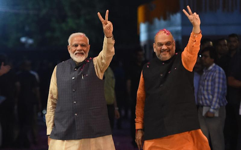Indian Prime Minister Narendra Modi (L) and Amit Shah (R) back in May 2019 - MONEY SHARMA/AFP
