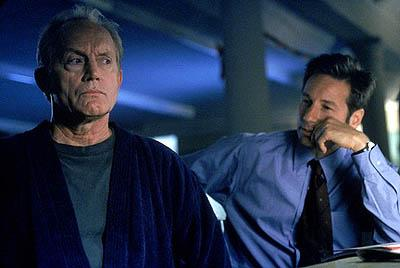"""Former FBI agent Frank Black (Lance Henriksen, L) is called in to help Agents Mulder (David Duchovny, R) and Scully investigate a series of bizarre murders linked to the Millennium Group in the """"Millennium"""" episode of Fox's The X-Files X-Files"""