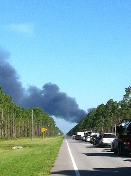 In this photo made available by Dylan Dunaway shows heavy smoke near Highway 98 near Mexico Beach, Fla., after a drone crashed on takeoff from Tyndall Air Force Base, Wednesday, July 17, 2013. The Air Force Base said the QF-4 drone crashed during a test, no one was injured. The highway remains closed because of possible fires from the crash. (AP Photo/Dylan Dunaway)