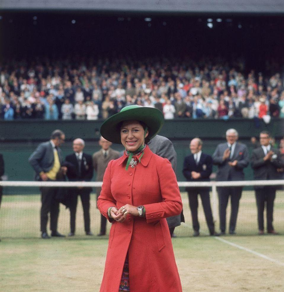 <p>Princess Margaret paired her red coat with a green sun hat. </p>