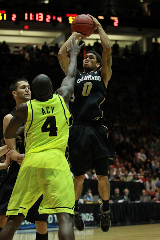 ALBUQUERQUE, NM - MARCH 17: Askia Booker #0 of the Colorado Buffaloes shoots against Quincy Acy #4 of the Baylor Bears in the second half of the game during the third round of the 2012 NCAA Men's Basketball Tournament at The Pit on March 17, 2012 in Albuquerque, New Mexico. Baylor won 80-63 in regualtion. (Photo by Ronald Martinez/Getty Images)