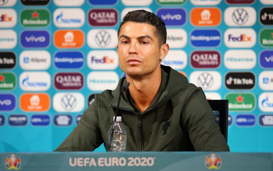 Cristiano Ronaldo moving two bottles of Coca-Cola out of his way at a press conference on Tuesday - Football's reliance on junk-food sponsorship - and why Cristiano Ronaldo could be a figurehead for change - SHUTTERSTOCK