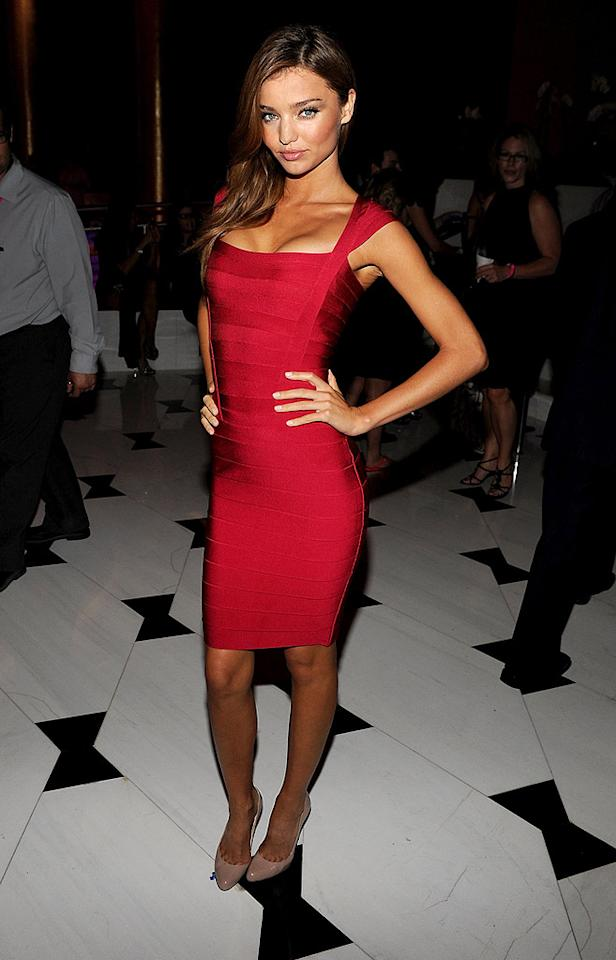 "Supermodel Miranda Kerr popped a pose in this body-hugging Herve Leger bandage dress. Jeffrey Mayer/<a href=""http://www.wireimage.com"" target=""new"">WireImage.com</a> - November 14, 2008"