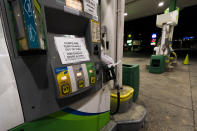 """A pump at a gas station in Silver Spring, Md., is out of service, notifying customers they are out of fuel, Thursday, May 13, 2021. Motorists found gas pumps shrouded in plastic bags at tapped-out service stations across more than a dozen U.S. states Thursday while the operator of the nation's largest gasoline pipeline reported making """"substantial progress"""" in resolving the computer hack-induced shutdown responsible for the empty tanks. (AP Photo/Manuel Balce Ceneta)"""