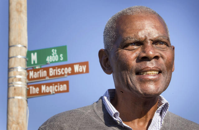 <p> FILE - In this Oct. 22, 2014, file photo, Marlin Briscoe stands in front of a street that was renamed for him in Omaha, Neb. The Pro Football Hall of Fame calls the Omaha, Neb. native the first black quarterback in the modern era of pro football. He opened the door for many, including Carolina's Cam Newton and Seattle's Russell Wilson, who both pay homage to him. (Kent Sievers/Omaha World-Herald via AP, File) </p>