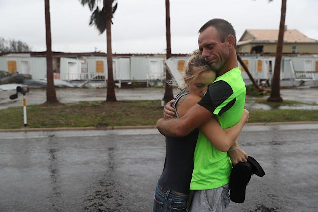 <p>Jessica Campbell hugs Jonathan Fitzgerald (L-R) after riding out Hurricane Harvey in an apartment on August 26, 2017 in Rockport, Texas. (Photo: Joe Raedle/Getty Images) </p>