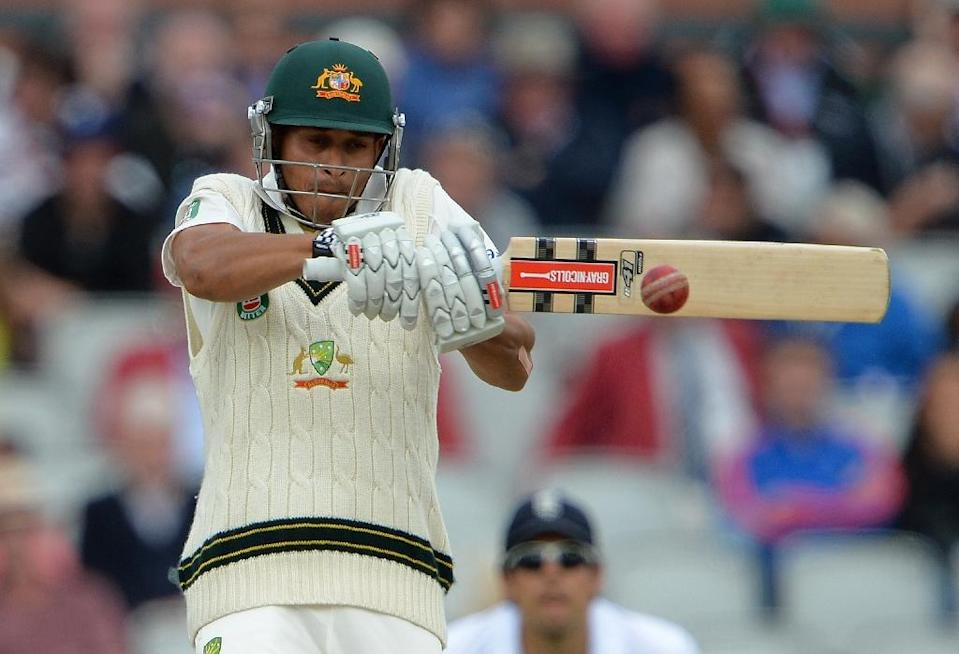 Australia's Usman Khawaja plays a shot during their Ashes Test match against England, at Old Trafford in Manchester, north-west England, in August 2013 (AFP Photo/Andrew Yates)
