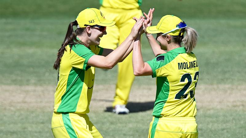 Sophie Molineux of Australia celebrates with team mate Annabel Sutherland after a wicket. (Getty Images)