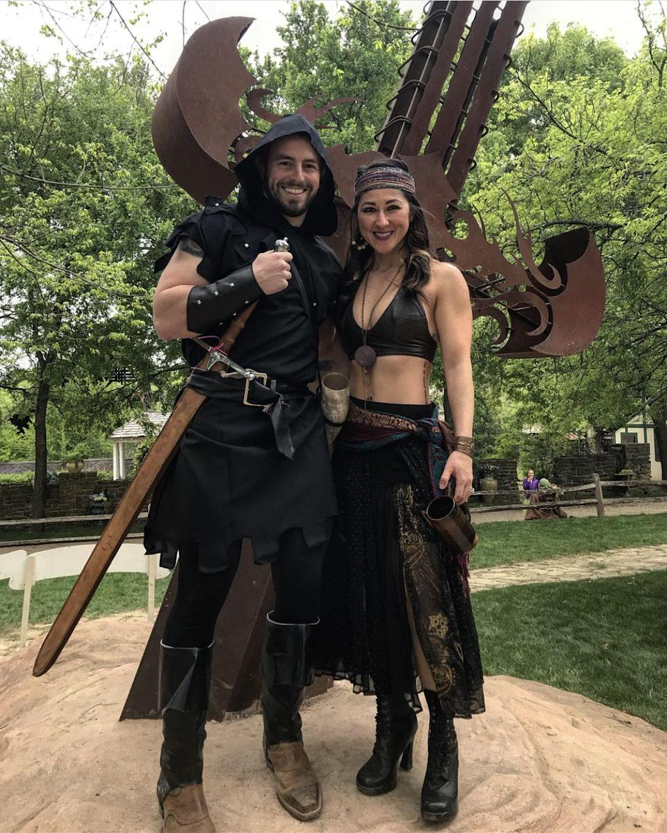"""<p>It's all about the accessories to make these looks come to life. The <a href=""""https://www.amazon.com/Vulcan-Gear-Medieval-Crusader-Scabbard/dp/B01M34L38E?tag=syn-yahoo-20&ascsubtag=%5Bartid%7C10050.g.22985658%5Bsrc%7Cyahoo-us"""" rel=""""nofollow noopener"""" target=""""_blank"""" data-ylk=""""slk:massive sword"""" class=""""link rapid-noclick-resp"""">massive sword</a> and <a href=""""https://www.amazon.com/Drinking-Viking-Medieval-Fantasy-lather/dp/B01L9ENE30?tag=syn-yahoo-20&ascsubtag=%5Bartid%7C10050.g.22985658%5Bsrc%7Cyahoo-us"""" rel=""""nofollow noopener"""" target=""""_blank"""" data-ylk=""""slk:drinking horn"""" class=""""link rapid-noclick-resp"""">drinking horn</a> especially add a punch of pizzaz. </p><p><strong>See more at <a href=""""https://www.instagram.com/p/BhWlxBohKKj/"""" rel=""""nofollow noopener"""" target=""""_blank"""" data-ylk=""""slk:@phatcouple"""" class=""""link rapid-noclick-resp"""">@phatcouple</a>.</strong></p><p><strong><a class=""""link rapid-noclick-resp"""" href=""""https://www.amazon.com/Vulcan-Gear-Medieval-Crusader-Scabbard/dp/B01M34L38E?tag=syn-yahoo-20&ascsubtag=%5Bartid%7C10050.g.22985658%5Bsrc%7Cyahoo-us"""" rel=""""nofollow noopener"""" target=""""_blank"""" data-ylk=""""slk:SHOP SWORDS"""">SHOP SWORDS</a><br></strong></p>"""