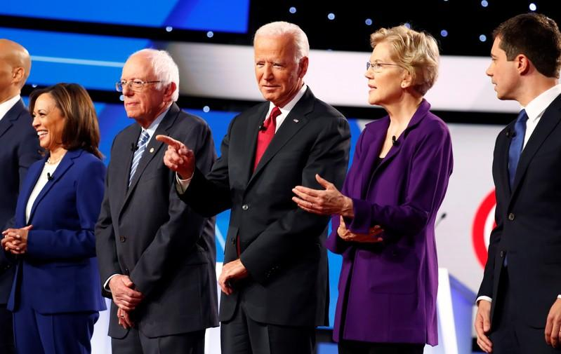 FILE PHOTO: Senator Harris, Senator Sanders, former Vice President Biden, Senator Warren and South Bend Mayor Buttigieg wait onstage before the fourth Democratic U.S. 2020 presidential election debate at Otterbein University in Westerville, Ohio
