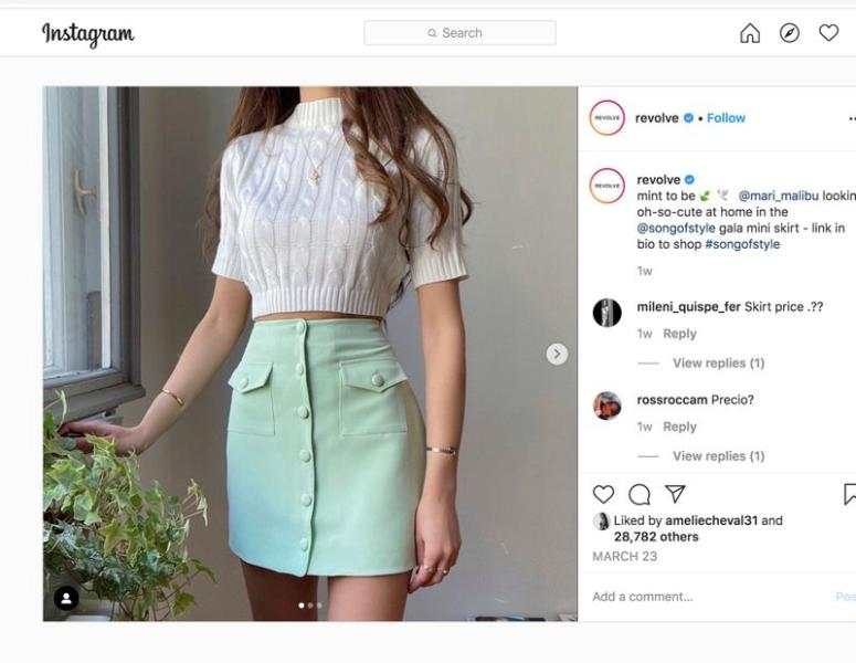 A model wears a $148 Song of Style mint-colored mini-skirt made by REVOLVE