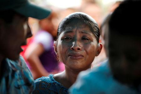 Claudia Maquin, mother of Jakelin Caal, a 7-year-old girl who handed herself in to U.S. border agents earlier this month and died after developing a high fever while in the custody of U.S. Customs and Border Protection, reacts during her daughter's funeral at her home village of San Antonio Secortez, in Guatemala December 25, 2018. REUTERS/Carlos Barria