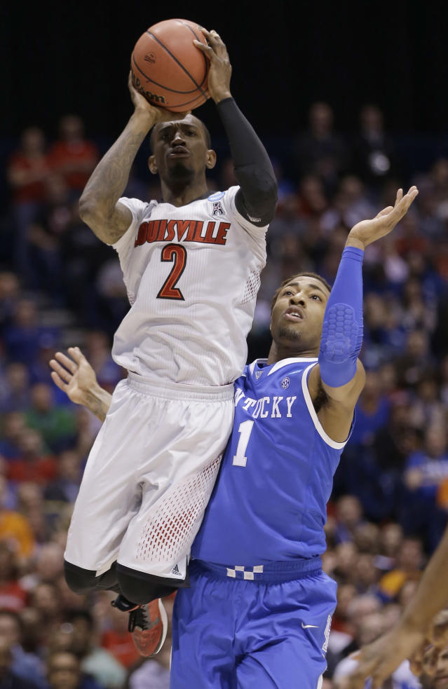 Louisville's Russ Smith (2) shoots past Kentucky's James Young (1) during the first half of an NCAA Midwest Regional semifinal college basketball tournament game Friday, March 28, 2014, in Indianapolis. (AP Photo/David J. Phillip)