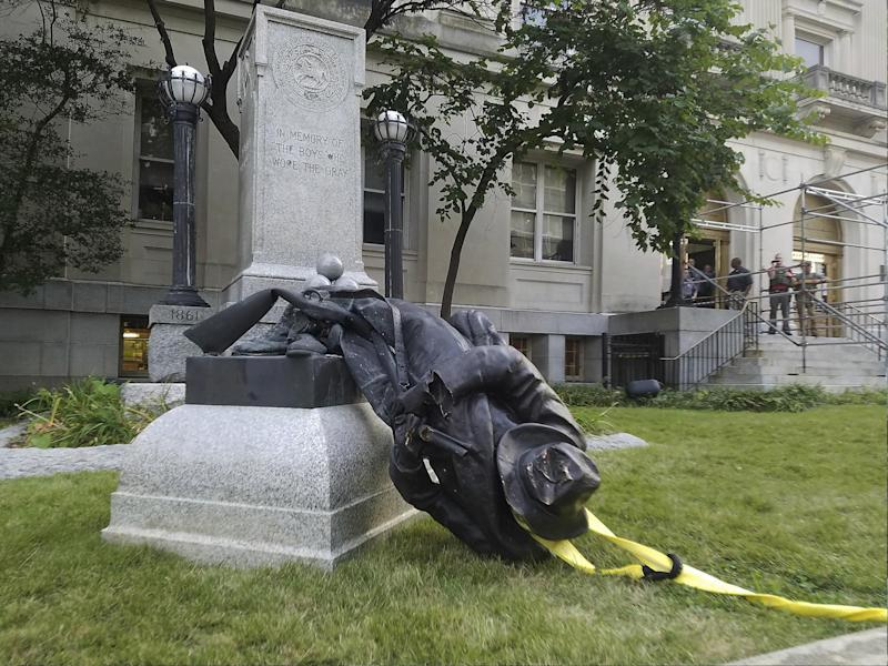 A toppled Confederate statue lies on the ground on 14 August 2017 in Durham, North Carolina where activists used a rope to pull it down after the violence in Charlottesville, Virginia: AP