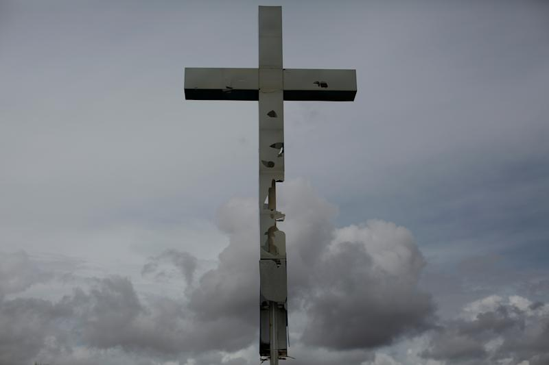 A vandalized cross in the hometown of Maroly Bastardo, in El Tigre, Venezuela, June 2, 2019. (Photo: Ivan Alvarado/Reuters)