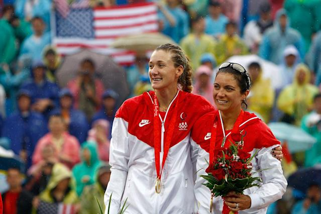Gold medalists Kerri Walsh and Misty May-Treanor of the United States celebrate after winning the women's gold medal match against China held at the Chaoyang Park Beach Volleyball Ground during Day 13 of the Beijing 2008 Olympic Games on August 21, 2008 in Beijing, China.