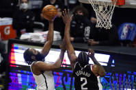 Brooklyn Nets guard James Harden, left, shoots as Los Angeles Clippers forward Kawhi Leonard defends during the first half of an NBA basketball game Sunday, Feb. 21, 2021, in Los Angeles. (AP Photo/Mark J. Terrill)