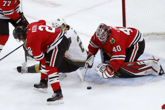 Chicago Blackhawks goaltender Robin Lehner makes a glove save as Duncan Keith (2) and Vegas Golden Knights center Cody Eakin look for the puck during the first period of an NHL hockey game Tuesday, Oct. 22, 2019, in Chicago. (AP Photo/Charles Rex Arbogast)