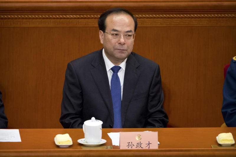 In this March 13, 2017 photo, the then-party secretary of Chongqing, Sun Zhengcai, attends a plenary session of China's National People's Congress (NPC) at the Great Hall of the People in Beijing. A Chinese politician considered a potential future leader has been replaced as head of the central mega-city of Chongqing amid reports he is facing a graft investigation. The Chongqing government said on its website Saturday, July 15, 2017, that Sun Zhengcai was being replaced as head of the city's Communist Party committee by Chen Min-er. (AP Photo/Mark Schiefelbein)