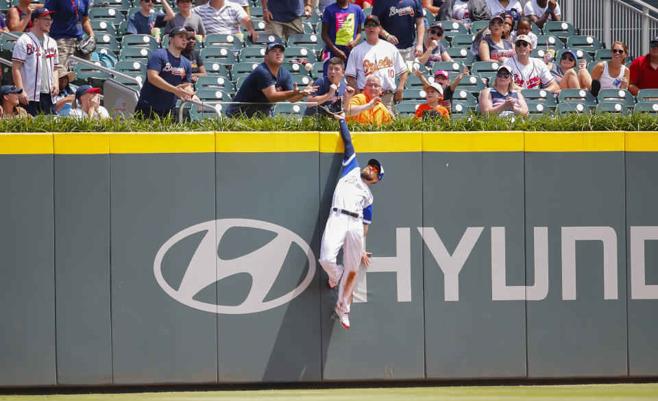 Atlanta Braves center fielder Ender Inciarte (11) leaps, but is unable to catch the home run ball of Baltimore Orioles' Mark Trumbo in the fifth inning of a baseball game, Sunday, June 24, 2018, in Atlanta. (AP Photo/Todd Kirkland)