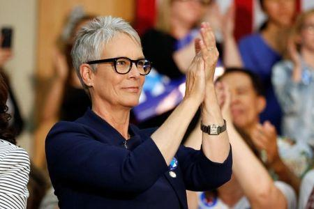 Actress Jamie Lee Curtis cheers for U.S. Democratic presidential candidate Hillary Clinton at the UFCW Union Local 324 in Buena Park