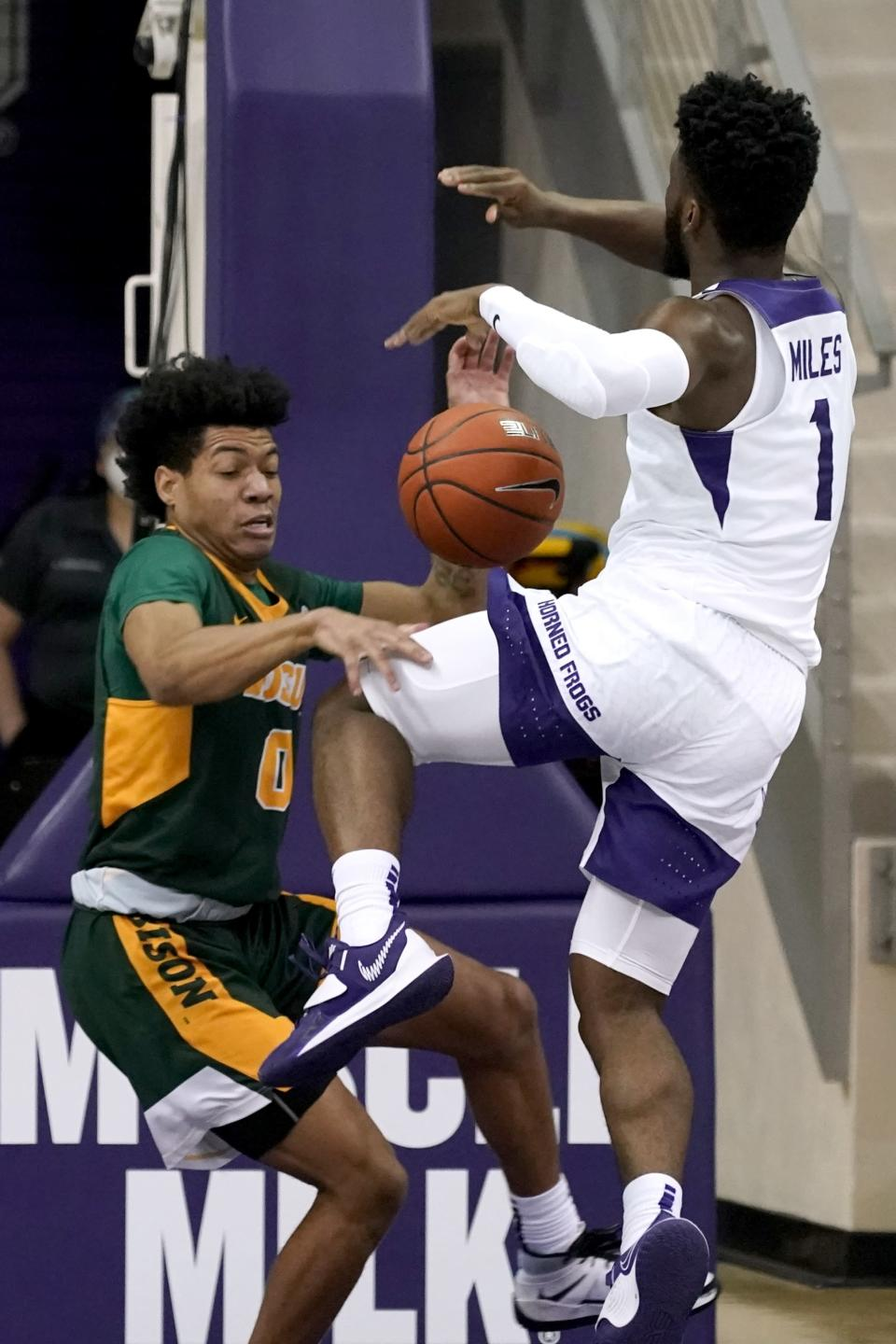 North Dakota State guard Dezmond McKinney (0) strips the ball away from TCU guard Mike Miles (1) as he drives to the basket for a shot in the first half of an NCAA college basketball game in Fort Worth, Texas, Tuesday, Dec. 22, 2020. (AP Photo/Tony Gutierrez)