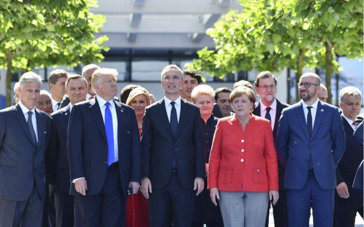 Mr Trump pictured with Angela Merkel and her fellow EU members outside the NATO summit in Brussels yesterday (Thursday) (Rex)