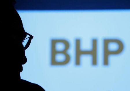 FILE PHOTO: BHP Billiton Chief Executive Andrew Mackenzie is silhouetted against a screen projecting the company's logo at a round table meeting with journalists in Tokyo, Japan June 5, 2017. REUTERS/Kim Kyung-Hoon/File Photo