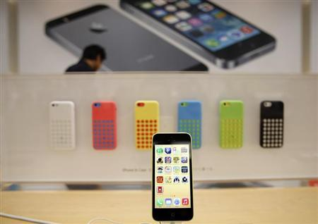 A new Apple iPhone 5C is displayed at an Apple Store at Tokyo's Ginza shopping district