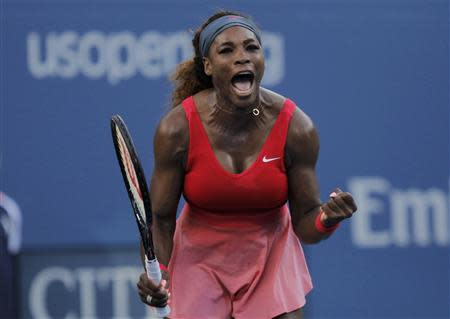 Serena Williams of the U.S. celebrates after defeating Li Na of China at the U.S. Open tennis championships in New York