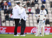 India's captain Virat Kohli, right, interacts with the umpires during the second day of the World Test Championship final cricket match between New Zealand and India, at the Rose Bowl in Southampton, England, Saturday, June 19, 2021. (AP Photo/Ian Walton)