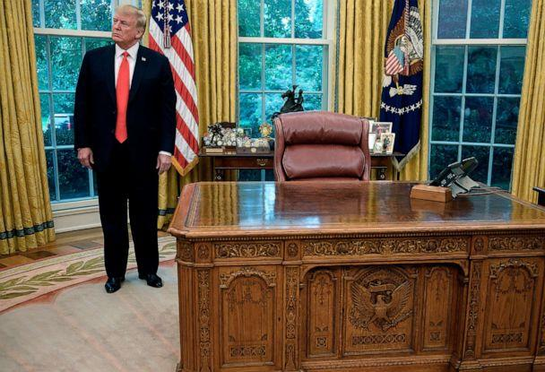 PHOTO: President Donald Trump stands in the Oval Office, Sept. 5, 2019, next to the HMS Resolute desk with a replica of the equestrian statue of Andrew Jackson by Clark Mills, behind his chair. (Jim Watson/AFP via Getty Images)