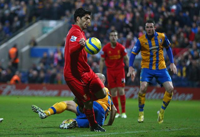 MANSFIELD, ENGLAND - JANUARY 06: Luis Suarez of Liverpool appears to control the ball with his hand during the FA Cup with Budweiser Third Round match between Mansfield Town and Liverpool at One Call Stadium on January 6, 2013 in Mansfield, England. (Photo by Clive Mason/Getty Images)