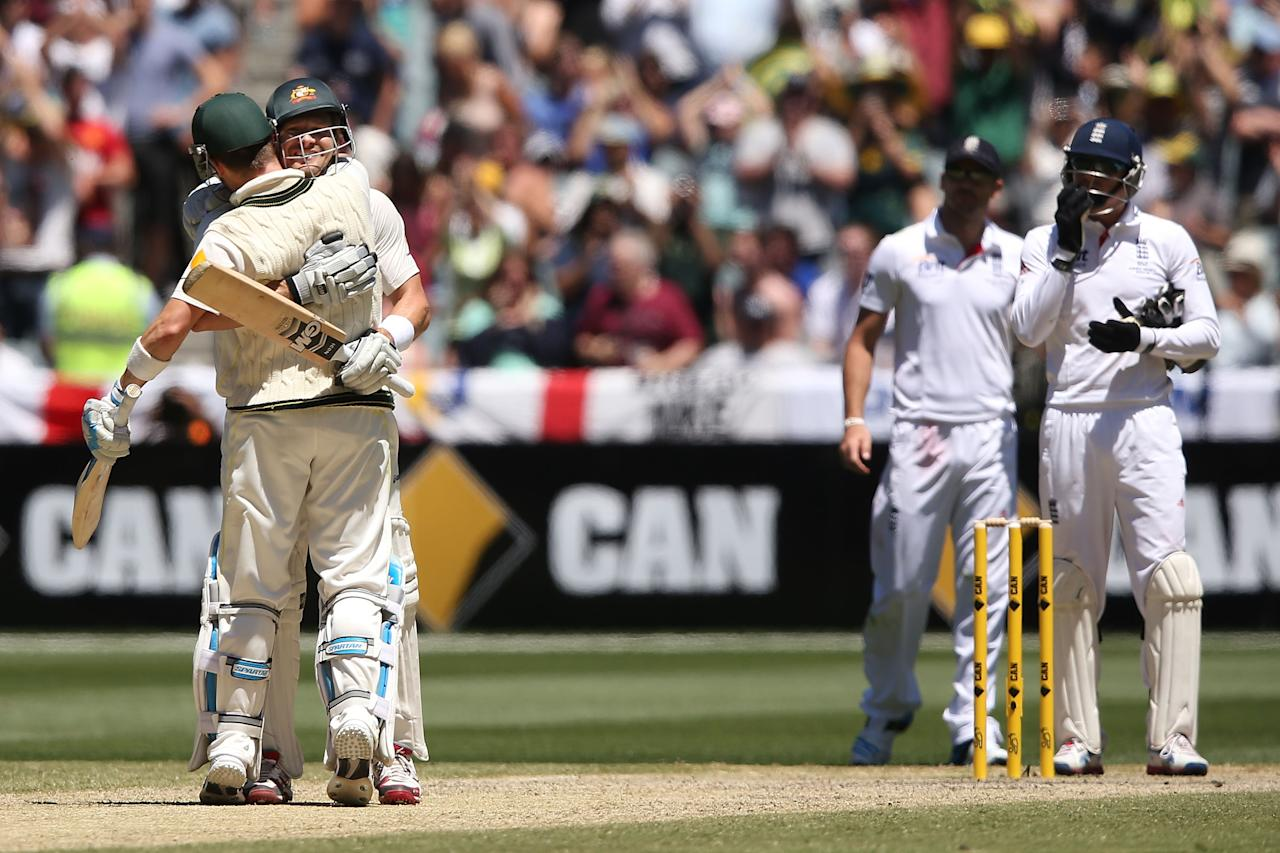 MELBOURNE, AUSTRALIA - DECEMBER 29:  Shane Watson of Australia celebrates hitting the winning runs with Michael Clarke (L) during day four of the Fourth Ashes Test Match between Australia and England at Melbourne Cricket Ground on December 29, 2013 in Melbourne, Australia.  (Photo by Michael Dodge/Getty Images)
