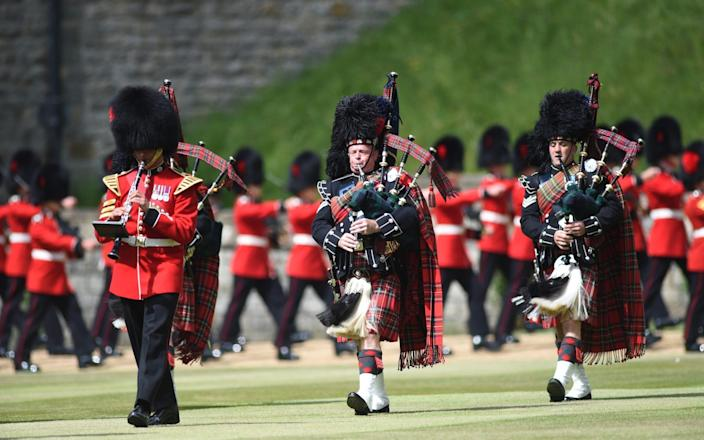 The Queen'€s Colour of F Company Scots Guards troop in tnhe Quadrangle at Windsor - EDDIE MULHOLLAND