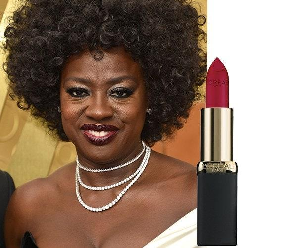 """Viola Davis's makeup artist Autumn Moultrie says Davis herself requested her dramatic look for the Emmys. As the <a href=""""https://www.glamour.com/story/viola-davis-is-the-new-face-of-loreal-paris?mbid=synd_yahoo_rss"""">new face of L'Oréal Paris</a>, she wore a full face of the brand. Moultrie used the <a href=""""https://shop-links.co/1684918325993086761"""" rel=""""nofollow"""">True Match Super Blendable Foundation</a> and <a href=""""https://shop-links.co/1684918368856579059"""" rel=""""nofollow"""">Infallible Full Wear Concealer</a> for her base. She used the <a href=""""https://shop-links.co/1684918435684959589"""" rel=""""nofollow"""">Colour Riche Pocket Palette in French Biscuit</a> and <a href=""""https://shop-links.co/1684918539218648696"""" rel=""""nofollow"""">Boudoir Charm</a> on her eyes, and finished off with <a href=""""https://shop-links.co/1684918573100895086"""" rel=""""nofollow"""">Colour Riche Matte Lipstick in Doesn't Matte-R</a> on her lips (the real star of her look)."""