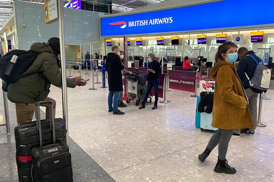 <p>British travelers returning to their homes in Spain wait to speak to airline staff after they were refused entry onto planes, at London's Heathrow airport </p> (AP)