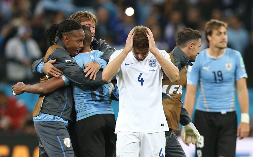 Steven Gerrard looks dejected after defeat to Uruguay at the 2014 World Cup. - Action Images / Lee Smith