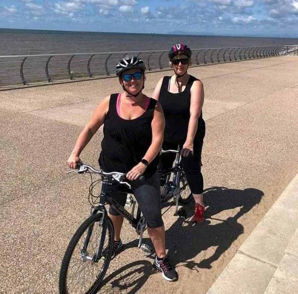 Nicky and her friend get to grips with a tandem bicycle (PA Real Life/Collect)