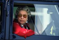 <p>At the wheel of a Land Rover, the Queen sported large sunglasses.</p>