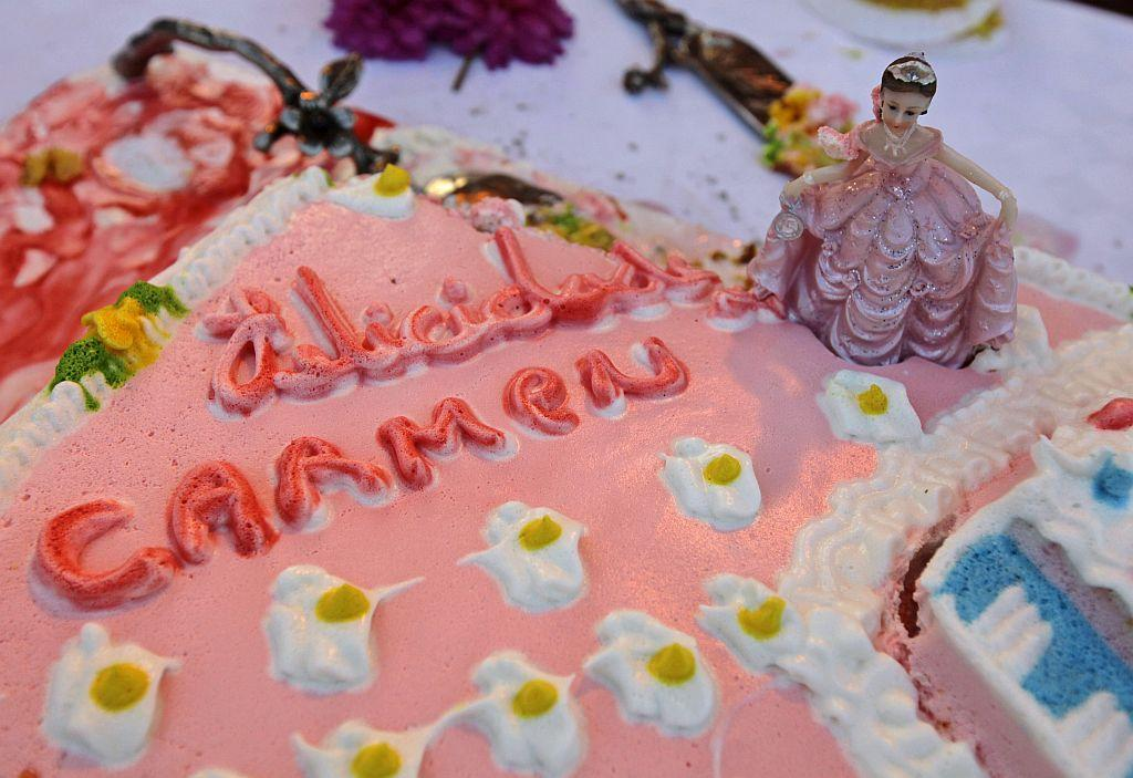 "<p>A cake with the words ""Congratulations Carmen"" is seen during Carmen Gonzalez's quinceanera (coming-out for 15-year-olds) party in Havana.</p>"