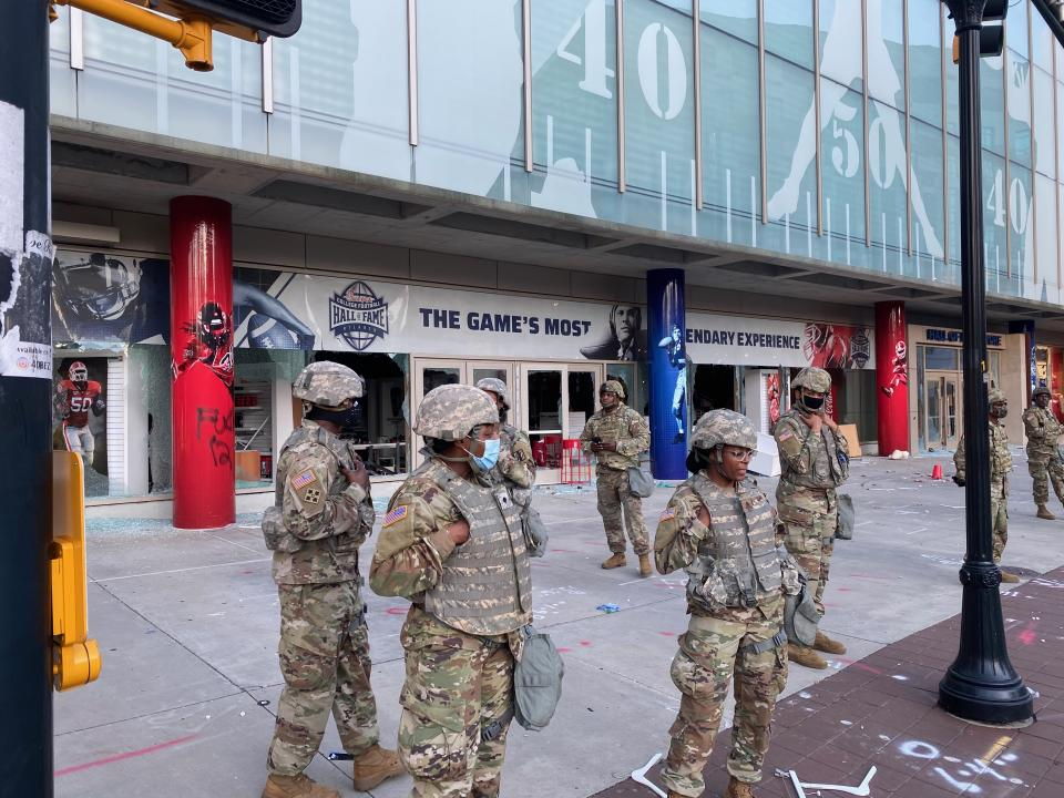 The National Guard stands in front of the College Football Hall of Fame in Atlanta. (Yahoo)