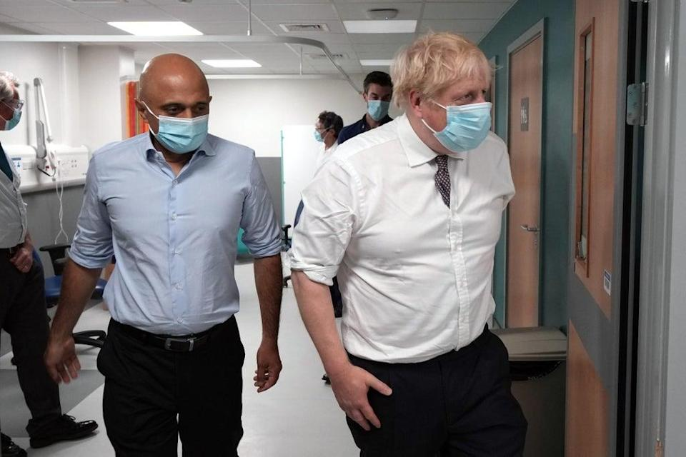 Boris Johnson and Sajid Javid speak with staff as they view an MRI scanner during a visit to Leeds General Infirmary (PA)