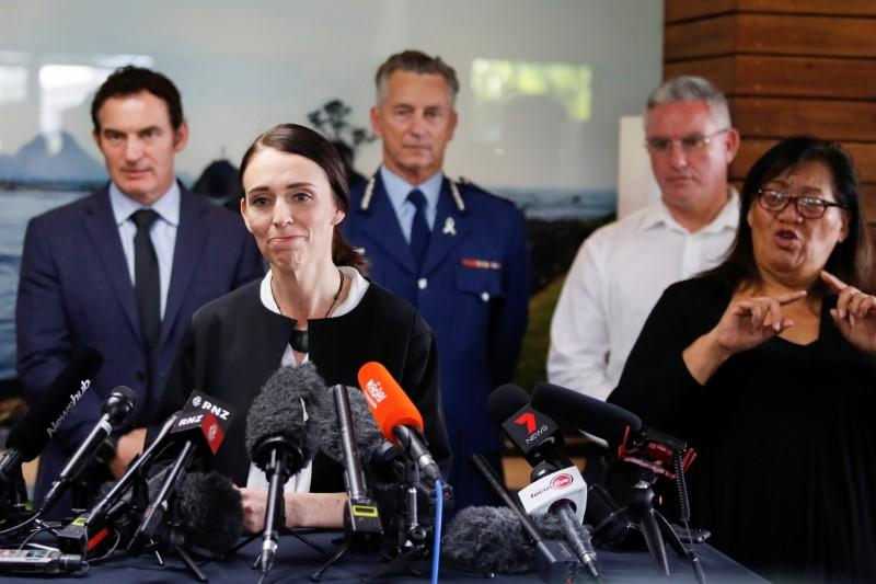 FILE PHOTO: New Zealand's Prime Minister Jacinda Ardern addresses the media in the aftermath of the eruption of White Island volcano, also known by its Maori name Whakaari, at Whakatane