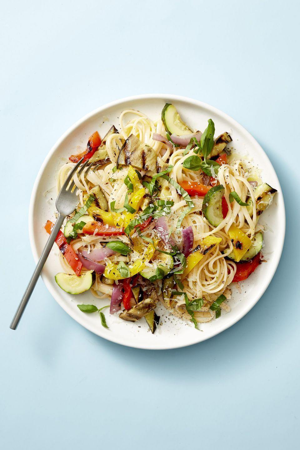 """<p>Lighten up your plate of pasta by going 50/50 with medley of grilled veggies. </p><p><em><a href=""""https://www.goodhousekeeping.com/food-recipes/easy/a21601536/grilled-ratatouille-linguine-recipe/"""" rel=""""nofollow noopener"""" target=""""_blank"""" data-ylk=""""slk:Get the recipe for Grilled Ratatouille Linguine »"""" class=""""link rapid-noclick-resp"""">Get the recipe for Grilled Ratatouille Linguine »</a></em></p><p><strong>RELATED: </strong><a href=""""https://www.goodhousekeeping.com/food-recipes/cooking/tips/g241/grilling-vegetables-guide/"""" rel=""""nofollow noopener"""" target=""""_blank"""" data-ylk=""""slk:18 Grilled Vegetable Recipes That Belong at Every BBQ"""" class=""""link rapid-noclick-resp"""">18 Grilled Vegetable Recipes That Belong at Every BBQ</a><br></p>"""